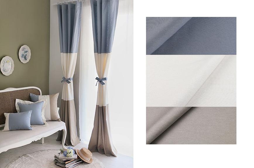 Портьеры и подушки в сочитании белого, голубого и серого цвета